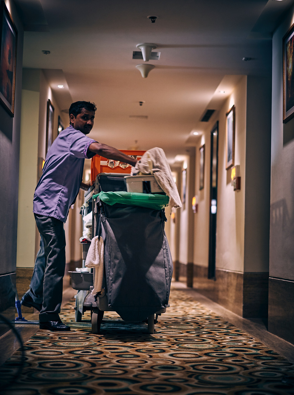 a service cleaner with a garbage bin