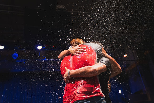 Two people hug during a baptism