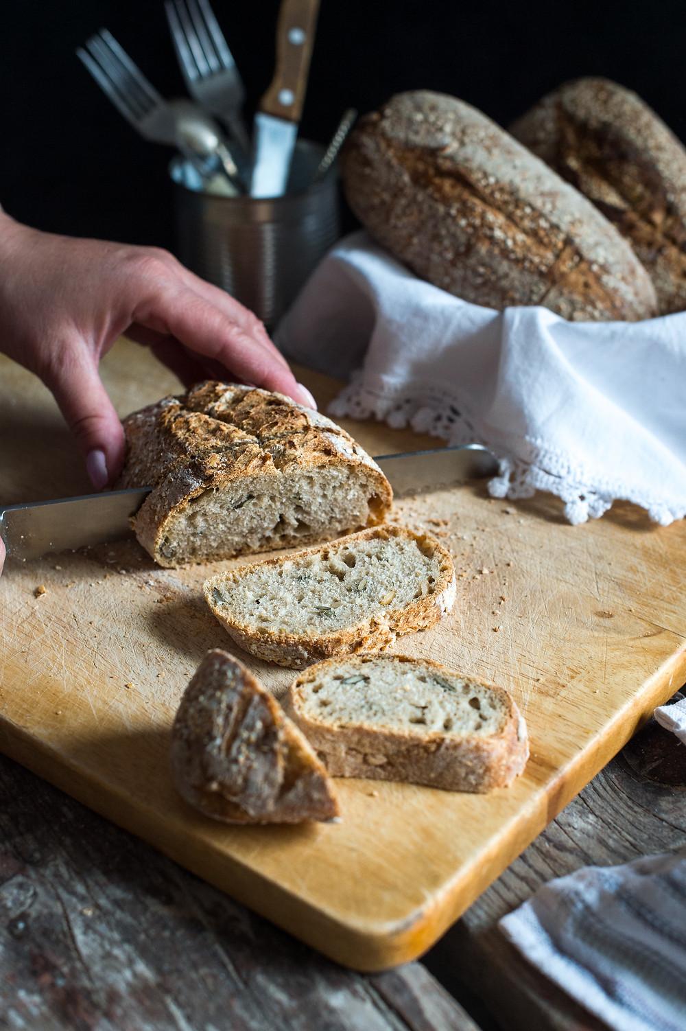 bread on a wooden cutting board sliced