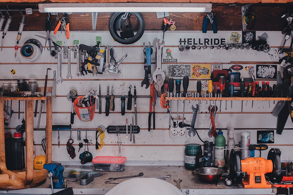 organized hand tools on garage wall