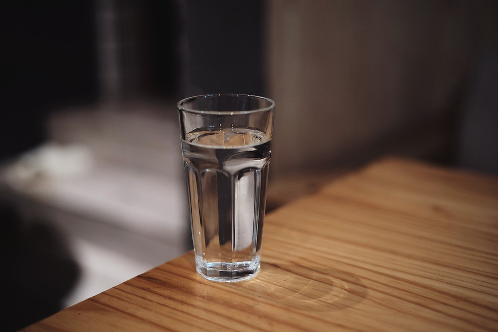 Glass of water on wooden table