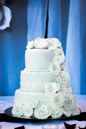 key west wedding cake with white roses