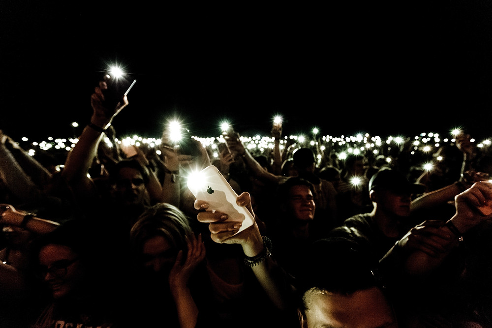 A crowd at night with cellphones