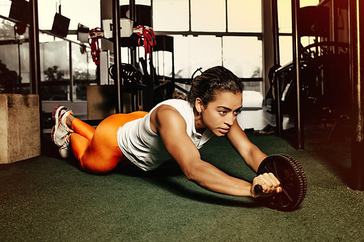 muscular woman working out with weights defying gender stereotypes