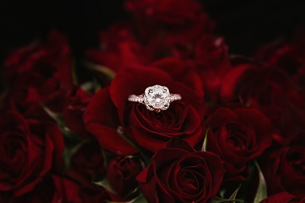 Diamond ring and red roses a perfect combination to express your love