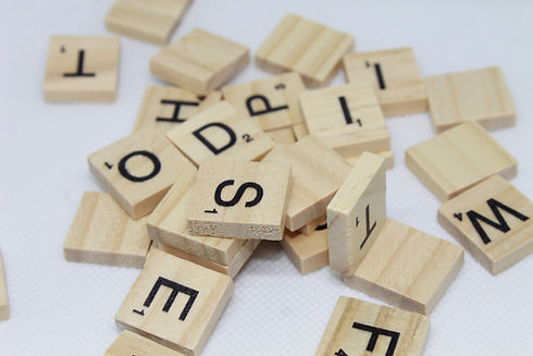 scrabble letter tiles in a pile