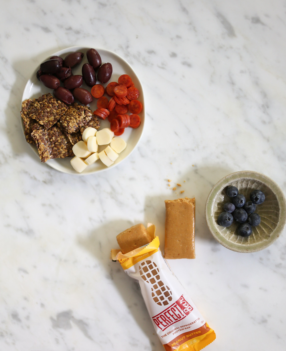 dried fruit, berries, granola, and peanut butter bar