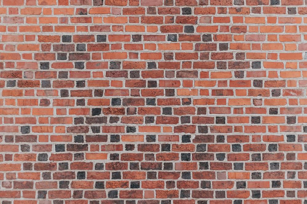brick wall representing activism