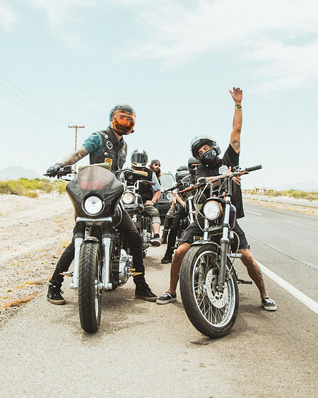 group of motorcycle riders on side of road