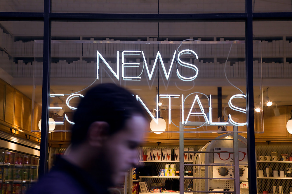 Neon news essentials sign