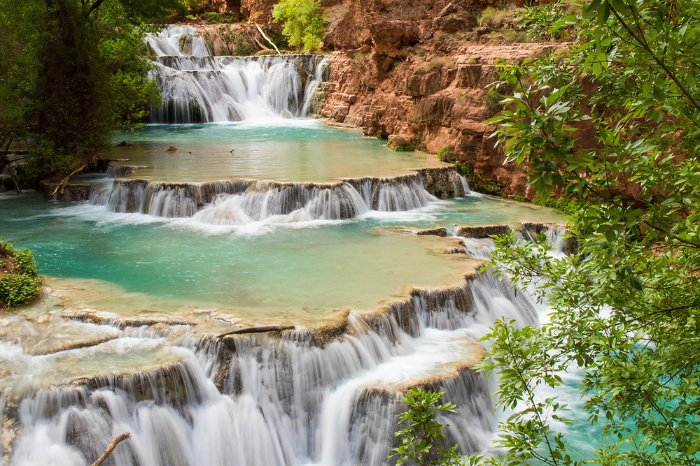 terraces of turquoise water and waterfalls