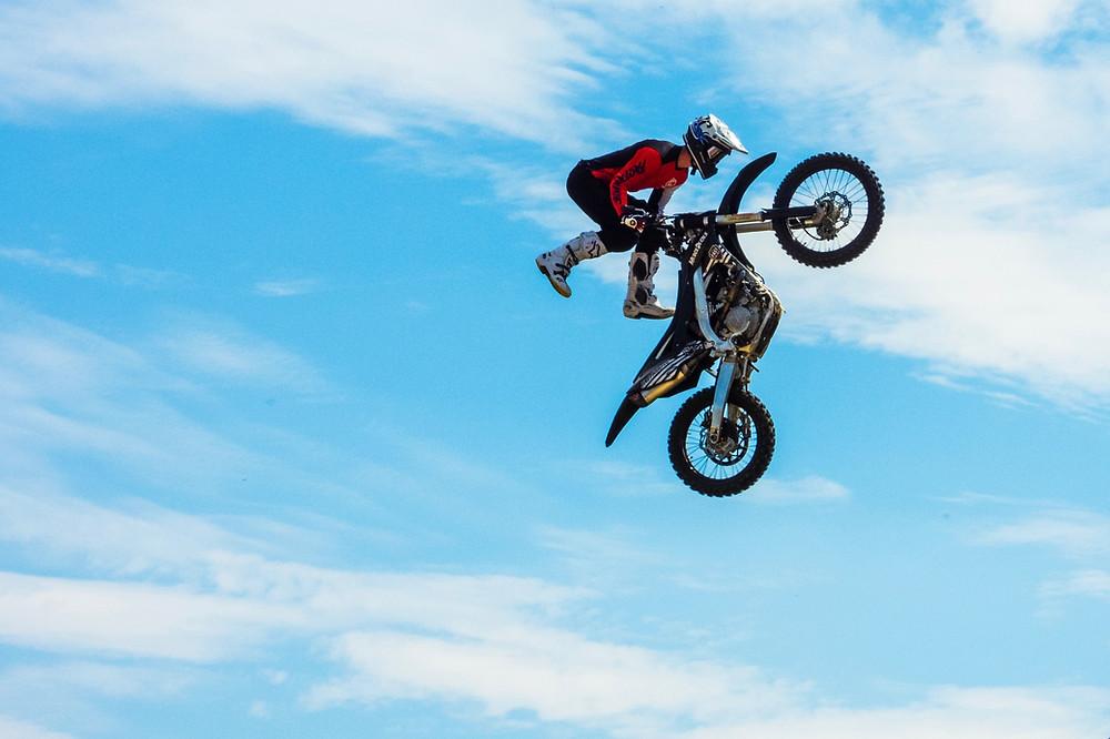 motorcycle rider doing airborne stunts