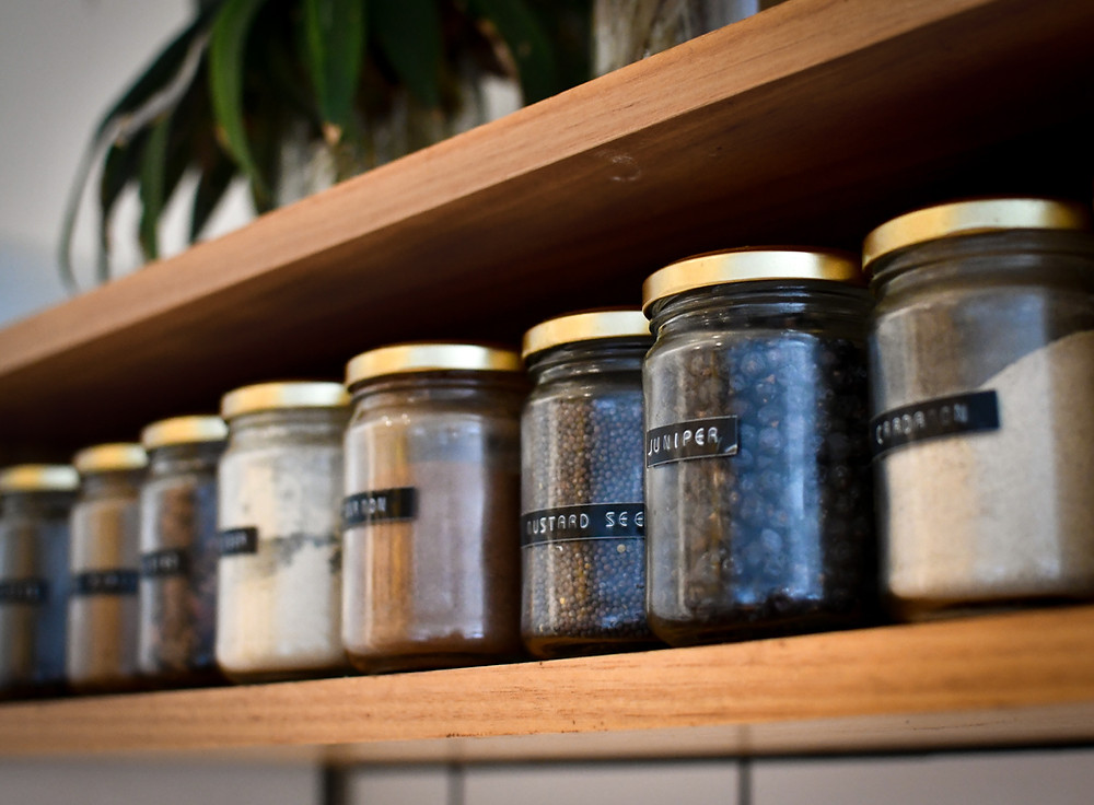 Glass jars with labels on the side