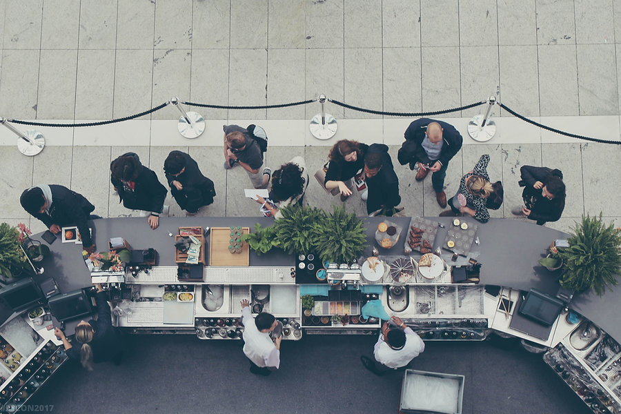 Queue of people at restaurant.
