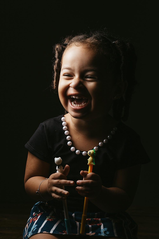 little girl laughing; by Jonathan Borba