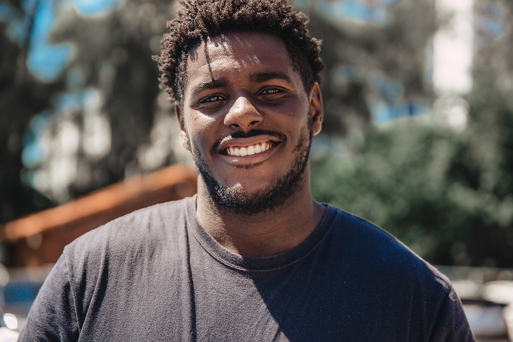 man smiling at sale of Ash Street Coop