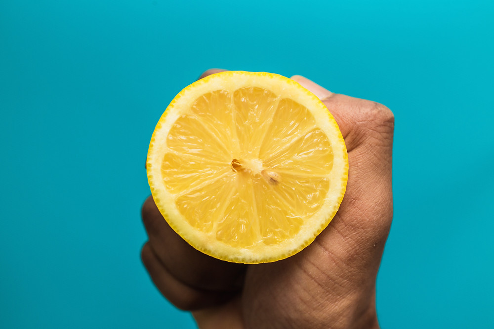 half a lemon held in a hand