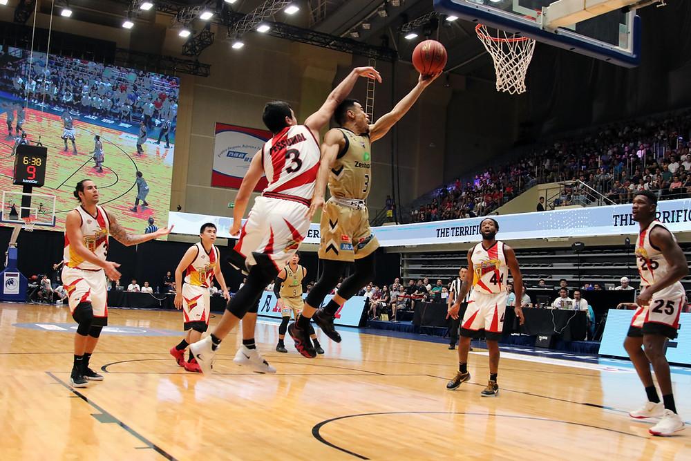 Players playing basketball
