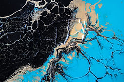 Abstract silver, black, tan, and blue paint mixture.