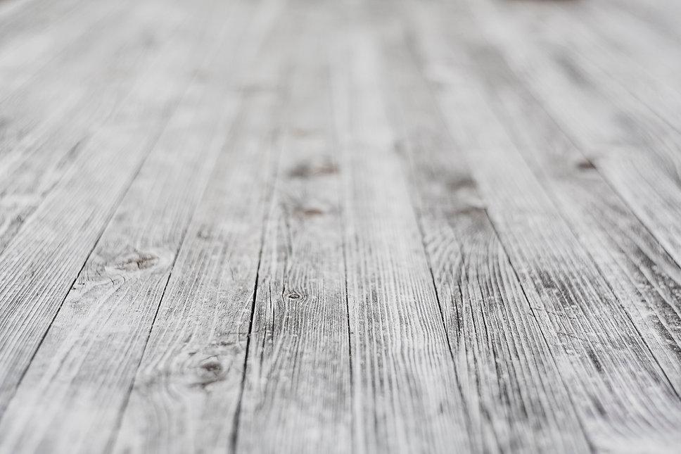 Grey wooden background.