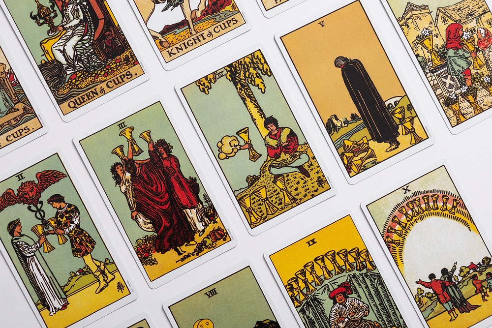 Traditional Tarot cards laid out in rows