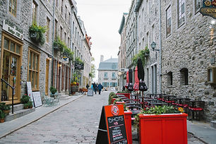 A nice little European looking roadway. Street is lined with bistro patios and quaint little boutiques. Plan my trip to Quebec City