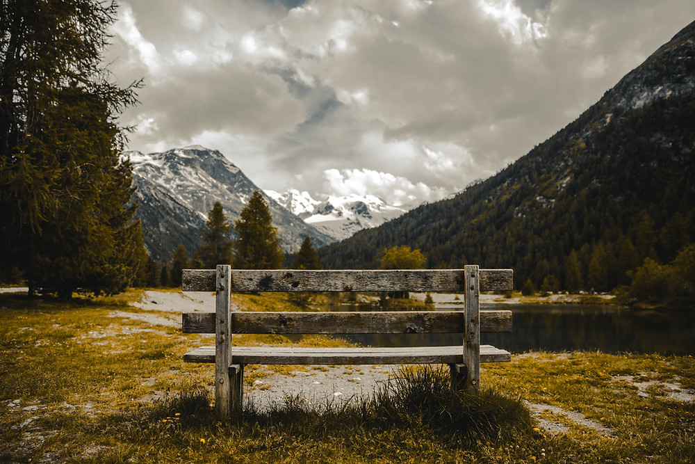 Wooden bench in the middle of the valley in winter weather