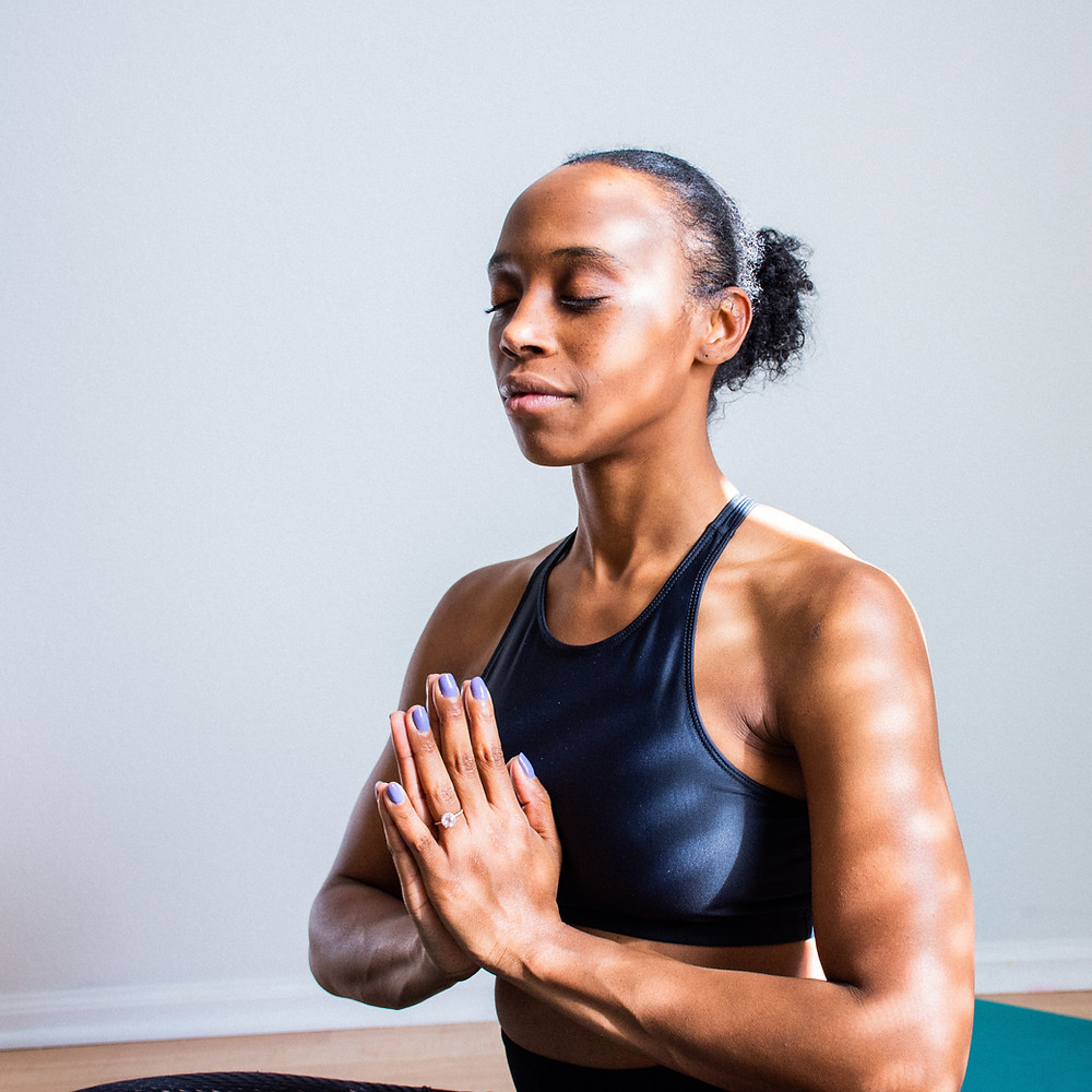 Woman practicing self care and beating depression by meditating.Catalyss Counseling provides treatment for depression in Colorado through online therapy and in person counseling in the Denver area 80209 and 80210