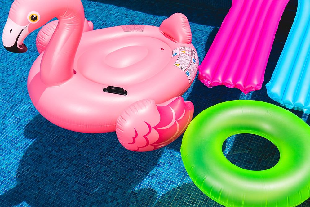 pool toys floating on water at aqua center in park forest IL