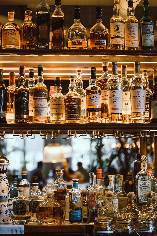 glass shelves liquor whiskey bourbon bartender