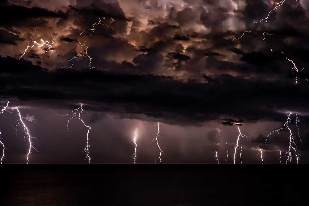 A lightning storm rages against a dark sky