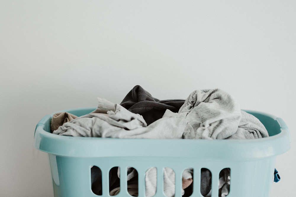 Full laundry basket with clothes inside