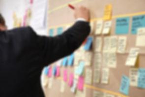 Man utilizing board for debt management