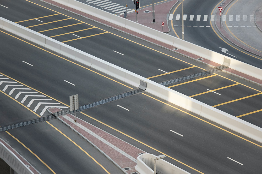 An empty city highway intersection represents the Covid-19 lockdown.