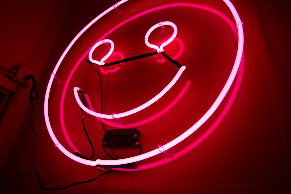 Pink neon light of smiley face
