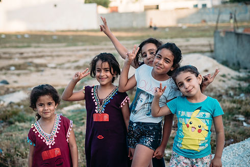 Image by abdelkader ft Girls flashing the victory sign