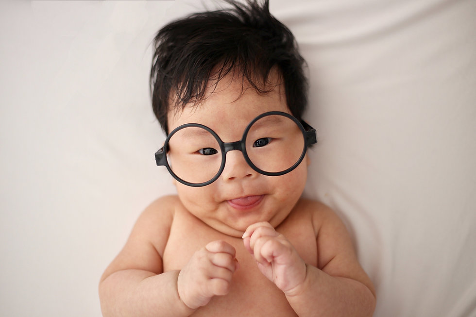 baby with eyeglass frame