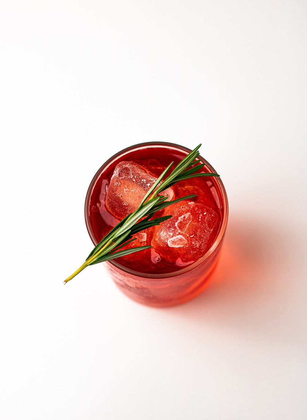 vermouth added red orange drink rosemary glass