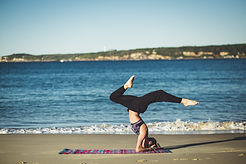 Woman doing yoga on the beach, Health benefits of Rooibos tea