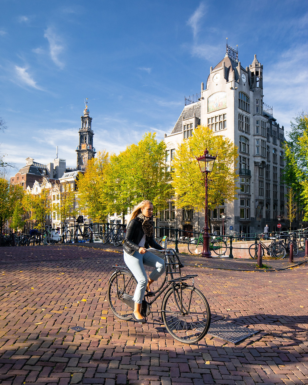woman riding a bike in a town square