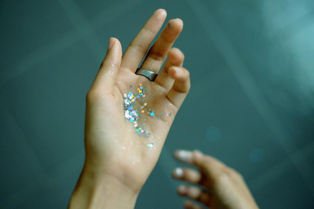 Hand holding glitter