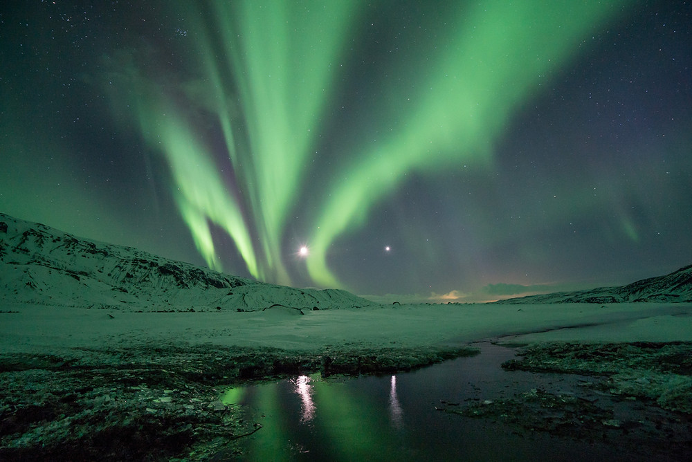 travel bucket list idea to watch the northern lights