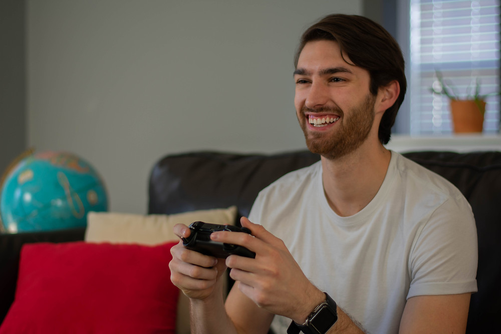 a guy playing video games for his birthday