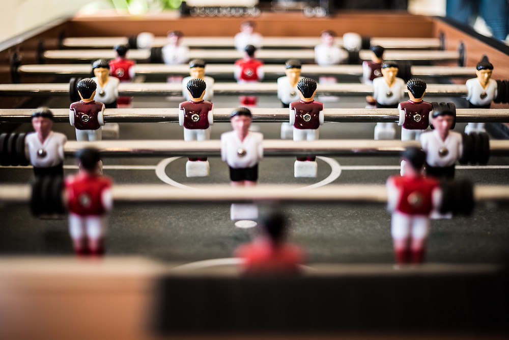 A foosball table, denoting that Arranger talents can move players into the right position - in soccer and in business.