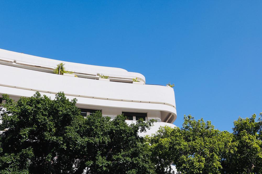 a white Bauhaus building in Tel Aviv