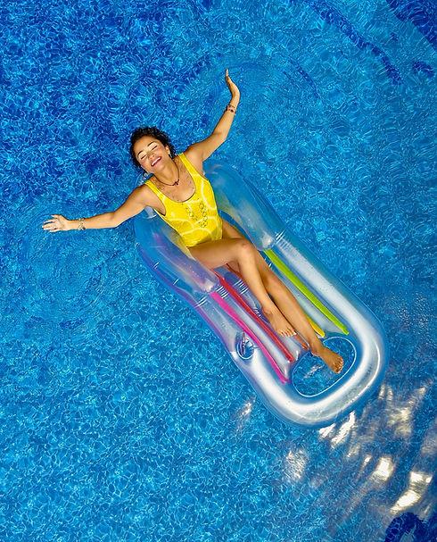 women on float in fiberglass pool