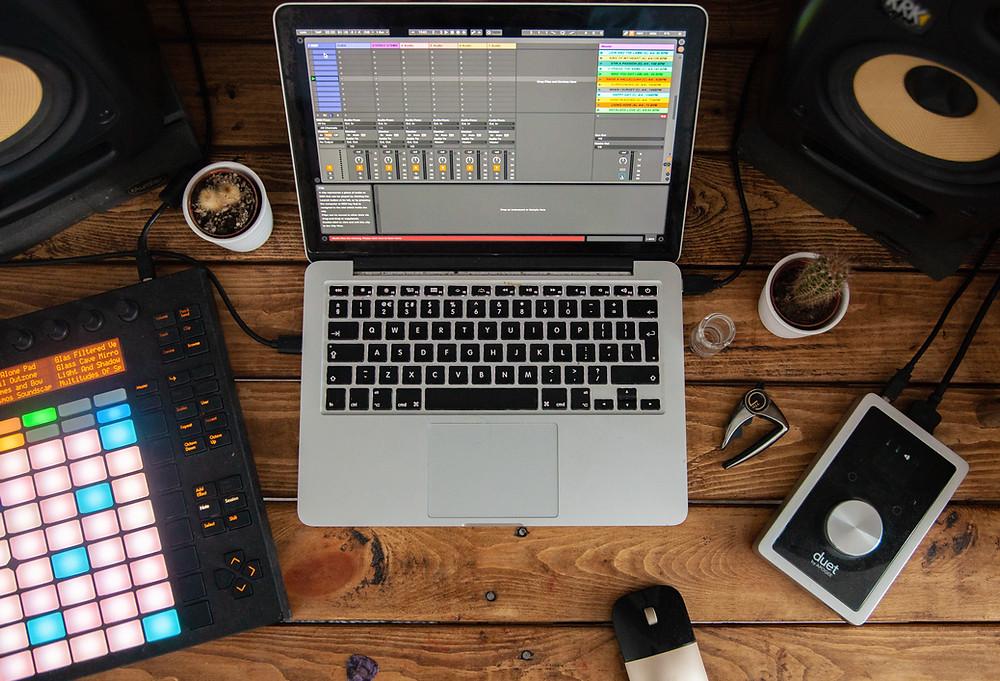 Laptop, midi board pad, at home music production set up