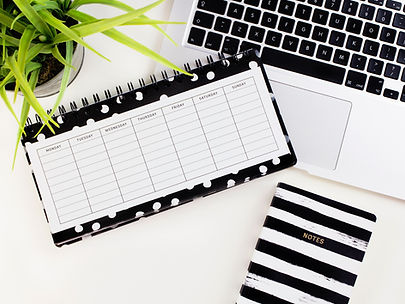 Planner and notebook open on laptop comuter keyboard Image by Emma Matthews Digital Content P