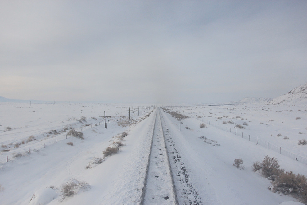 Railroad tracks covered in snow, color photo