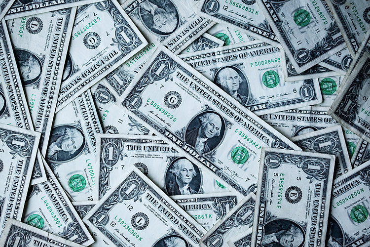 Scattered US one dollar bills